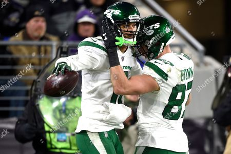 New York Jets wide receiver Robby Anderson, left, is congratulated by tight end Daniel Brown (87) after catching a two-point conversion pass from quarterback Sam Darnold, not visible, during the second half of an NFL football game against the Baltimore Ravens, in Baltimore