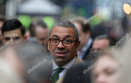 Chairman of the Conservative Party, James Cleverly waits for Britain's Prime Minister Boris Johnson to address the media outside 10 Downing Street in London,. Johnson's Conservative Party has won a thumping majority of seats in Britain's Parliament ? a decisive outcome to a Brexit-dominated election that should allow Johnson to fulfill his plan to take the U.K. out of the European Union next month