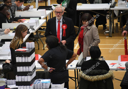 Stock Photo of British opposition Labour Party leader Jeremy Corbyn and his wife Laura Alvarez speak to vote tellers after arriving for the declaration of his seat in the 2019 general election in Islington, London, . The first handful of results to be declared in Britain's election are showing a surge in support for to the Conservatives in northern England seats where Labour has long been dominant