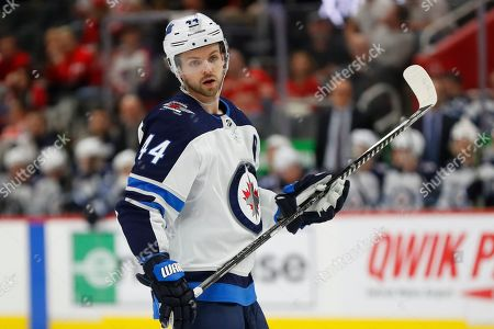 Winnipeg Jets defenseman Josh Morrissey (44) plays against the Detroit Red Wings in the first period of an NHL hockey game, in Detroit