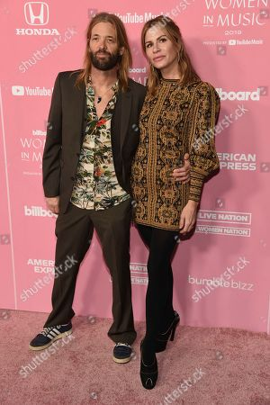 Taylor Hawkins, Alison Hawkins. Taylor Hawkins, left, and Alison Hawkins arrive at Billboard's Women in Music at the Hollywood Palladium, in Los Angeles