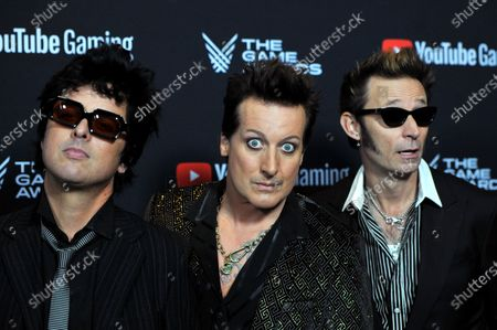 Greenday band members Billie Joe Armstrong, Tre Cool  and Mike Dirnt attend the 2019 Game Awards in Los Angeles, California, USA, 12 December 2019. The Game Awards, founded in 2014, is held to highlight creative and technical achievements in the worldwide video game industry and competitive gaming community.