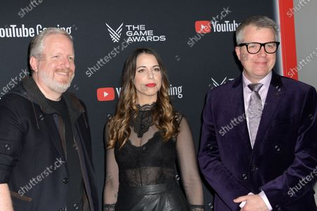 Stock Image of US video game producer Rod Fergusson, US voice actor Laura Bailey and XBOX Live director of programming Larry Hryb attend the the 2019 Game Awards in Los Angeles, California, USA, 12 December 2019. The Game Awards, founded in 2014, is held to highlight creative and technical achievements in the worldwide video game industry and competitive gaming community.