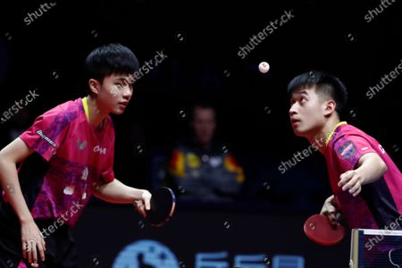 Liao Cheng-Ting (R) and Lin Yun-Ju (L) of Chinese Taipei in action against Timo Boll and Patrick Franziska of Germany (not pictured) during their Men's Doubles semifinals match of the ITTF World Tour Grand Finals Table Tennis tournament in Zhengzhou, China, 13 December 2019.
