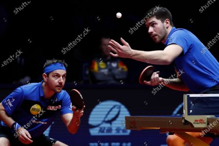 Timo Boll (L) and Patrick Franziska (R) of Germany in action against Liao Cheng-Ting and Lin Yun-Ju of Chinese Taipei (not pictured) during Men's Doubles semifinals match of the ITTF World Tour Grand Finals Table Tennis tournament in Zhengzhou, China, 13 December 2019.