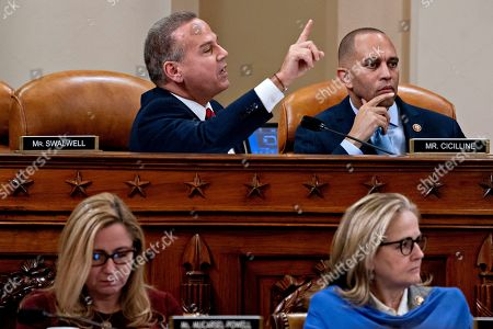 David Cicilline, Hakeem Jeffries, Madeleine Dean, Debbir Mucarsel-Powell. Rep. David Cicilline, D-R.I., top left, speaks as Rep. Hakeem Jeffries, D-N.Y., and chair of the Democratic Caucus, top right, as Rep. Madeleine Dean, D-Penn., bottom right, and Rep. Debbie Mucarsel-Powell, D-Fla, bottom left, during a House Judiciary Committee markup of Articles of Impeachment against President Donald Trump, on Capitol Hill in Washington