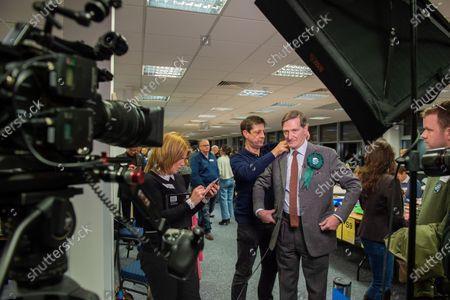 Stock Image of Independent candidate Dominic Grieve prepares for a TV interview after arriving at the offices of the South Bucks District Council for the Beaconsfield constituency vote count.