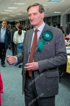 Stock Photo of Independent candidate Dominic Grieve prepares for a TV interview after arriving at the offices of the South Bucks District Council for the Beaconsfield constituency vote count.