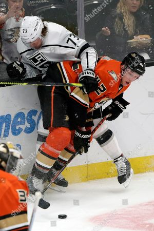 Josh Manson, Tyler Toffoli. Anaheim Ducks defenseman Josh Manson, right, checks Los Angeles Kings right wing Tyler Toffoli, top left, against the boards during the third period of an NHL hockey game in Anaheim, Calif