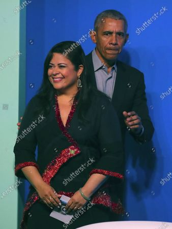 Former US president Barack Obama (R) and his sister Maya Soetoro-ng (L) arrive on stage at an Obama Foundation event in Kuala Lumpur, Malaysia, 13 December 2019. Obama and his wife Michelle are in Kuala Lumpur for the inaugural Leaders: Asia-Pacific conference, focused on promoting women's education in the region.
