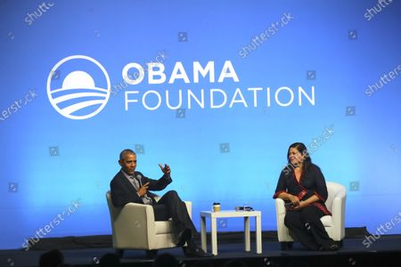 Former US president Barack Obama (L) and his sister Maya Soetoro-ng (R) talk on stage at an Obama Foundation event in Kuala Lumpur, Malaysia, 13 December 2019. Obama and his wife Michelle are in Kuala Lumpur for the inaugural Leaders: Asia-Pacific conference, focused on promoting women's education in the region.