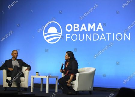 Stock Photo of Former US president Barack Obama (L) and his sister Maya Soetoro-ng (R) talk on stage at an Obama Foundation event in Kuala Lumpur, Malaysia, 13 December 2019. Obama and his wife Michelle are in Kuala Lumpur for the inaugural Leaders: Asia-Pacific conference, focused on promoting women's education in the region.