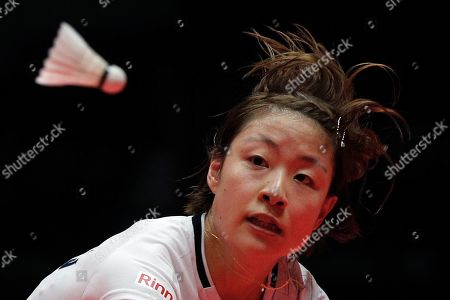 Japan's Nozomi Okuhara eyes on the shutter cock as she plays against Thailand's Ratchanok Intanon during their women's singles match at the World Tour Finals in Guangzhou in south China's Guangdong province