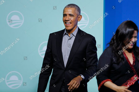 """Stock Image of Barack Obama, Maya Soetoro-Ng. Former U.S. President Barack Obama with his sister Maya Soetoro-Ng arrives for the """"values-based leadership"""" during a plenary session of the Gathering of Rising Leaders in the Asia Pacific, organized by the Obama Foundation in Kuala Lumpur, Malaysia"""