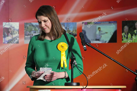 Lib Dem leader Jo Swinson, second right, reacts as she loses her East Dumbartonshire constituency, during the count at the Leisuredome, Bishopbriggs, Scotland