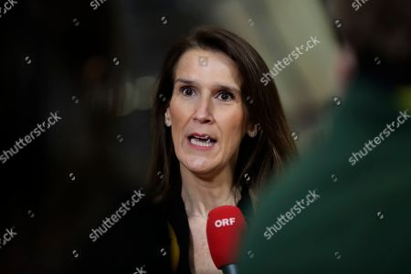 Belgian Prime Minister Sophie Wilmes speaks with the media as she arrives for an EU summit in Brussels, . European Union leaders are gathering Friday to discuss Britain's departure from the bloc amid some relief that Prime Minister Boris Johnson has secured an election majority that should allow him to push the Brexit deal through parliament