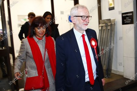 Stock Picture of Labour Party Leader Jeremy Corbyn leaves party headquarters by the back door with his wife Laura Alvarez after the 2019 General Election results showed a majority for the Conservative Party. The Conservatives are predicted to win the election with a majority of 64 seats.