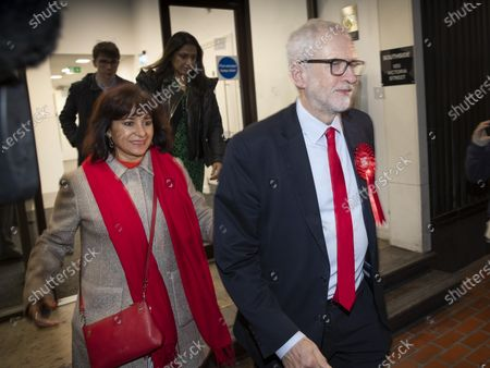 Labour Party Leader Jeremy Corbyn leaves party headquarters by the back door with his wife Laura Alvarez after the 2019 General Election results showed a majority for the Conservative Party. The Conservatives are predicted to win the election with a majority of 64 seats.