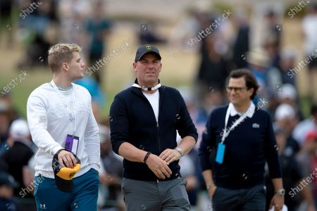 Stock Photo of Former Australian cricket player Shane Warne walks the fairway during round 3 of The Presidents Cup