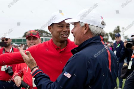 Tiger Woods of team USA celebrates winning his tie with Fred Couples of team USA during the final round of The Presidents Cup