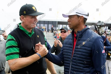 Ernie Els of South Africa congratulates Tiger Woods of team USA during the final round of The Presidents Cup