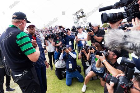 Tiger Woods of team USA speaks with Ernie Els of South Africa after the final round of The Presidents Cup