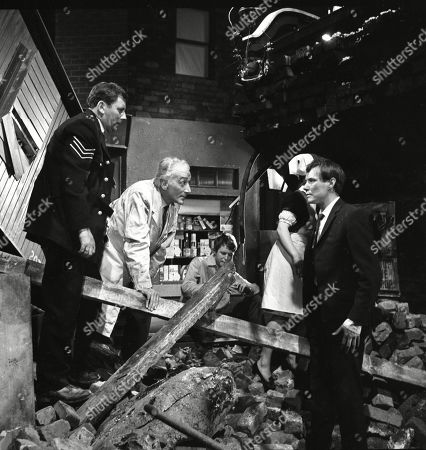 A Train crashes from the viaduct onto Coronation Street.  James Beck (as Sergeant Bowdon), Paul Bacon (as Doctor), Alan Rothwell (as David Barlow) and Colin Edwynn (as Jimmie Conway)