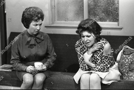 A Train crashes from the viaduct onto Coronation Street.  Joan Francis (as Dot Greenhalgh) and Pat Phoenix (as Elsie Tanner)