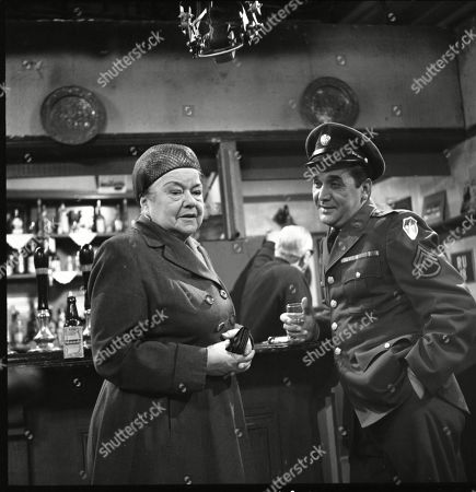 Violet Carson (as Ena Sharples) and Bill Nagy (as Gregg Flint)