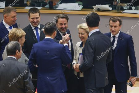 (L-R) Romanian President Klaus Iohannis, German Chancellor Angela Merkel, Estonian Prime Minister Juri Ratas, Slovenian Prime Minister Marjan Sarec, Prime Minister of Luxembourg Xavier Bettel, European Commission President Ursula von der Leyen,  Dutch Prime Minister Mark Rutte and French President Emmanuel Macron at the start of the second day of the European Council summit in Brussels, Belgium, 13 December 2019. EU leaders gathered in Brussels on 12 and 13 December to discuss climate change, the EU's long-term budget and external relations, the economic and monetary union and Brexit, among other issues.
