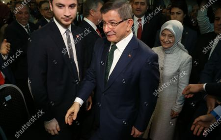 Former Turkish prime minister Ahmet Davutoglu (C) and his wife Sare (R) arrive for the presentation of the newly established Gelecek Party (Future Party) in Ankara, Turkey, 13 December 2019.  Davutoglu, who served as prime minister from 2014 to 2016 under Turkish President Erdogan's ruling Justice and Development Party (AK Party), announced the formation of the new breakaway conservative party to challenge Erdogan after his resignation from the AK Party in September 2019.