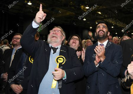 SNP MSP Humza Yousaf celebrates as the SNP win all seven of the constituency seats in Glasgow and 48 seats throughout Scotland in the General Election.