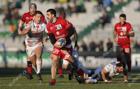 Stock Picture of Lyon's Pato Fernandez looks for support as Benetton Treviso's Luca Morisi closes him down.