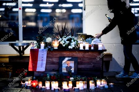 A fan takes pictures at a makeshift memorial for Swedish pop singer and songwriter Marie Fredriksson outside Baggpipe Studios (formerly known as EMI) in Skarmabrink, southern Stockholm
