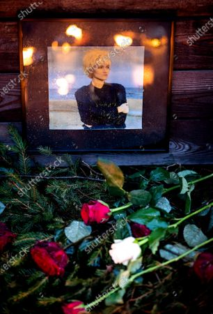 Flowers and a photo are placed at a makeshift memorial for Swedish pop singer and songwriter Marie Fredriksson outside Baggpipe Studios (formerly known as EMI) in Skarmabrink, southern Stockholm