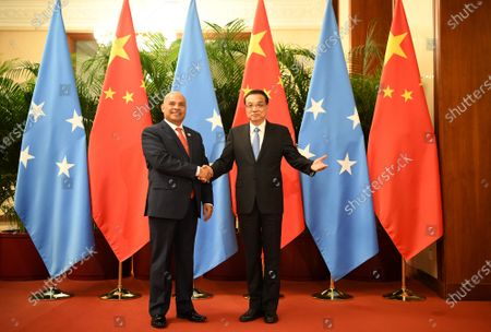 Chinese Premier Li Keqiang shakes hands with Micronesian President David Panuelo (L) at the Great Hall of the People in Beijing, China, 13 December 2019.