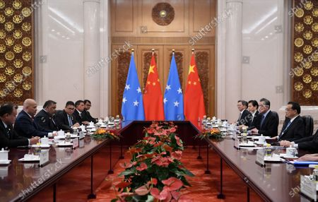Chinese Premier Li Keqiang (R) talks with Micronesian President David Panuelo (2-L) during their meeting at the Great Hall of the People in Beijing, China, 13 December 2019.