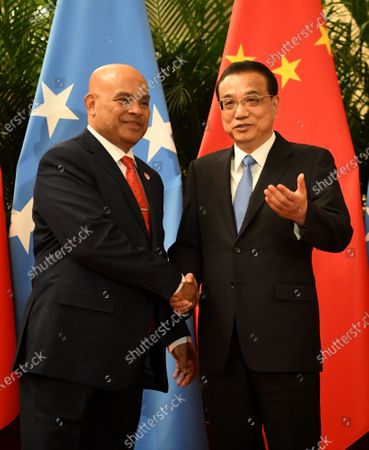 Stock Image of Chinese Premier Li Keqiang shakes hands with Micronesian President David Panuelo (L) at the Great Hall of the People in Beijing, China, 13 December 2019.