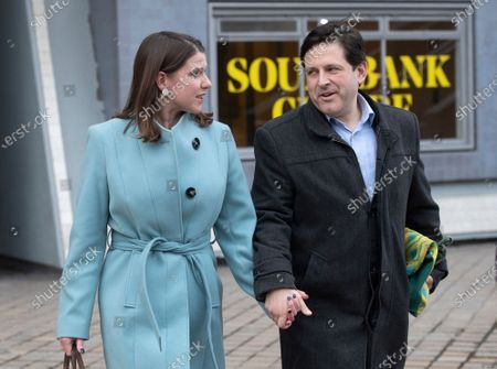 Britain's Liberal Democrat leader Jo Swinson (L) and husband Duncan Hames (R) leave the Southbank centre in London, Britain, 13 December 2019. Britons went to the polls for a general election on 13 December 2019, which the Conservative Party has won an overall majority.