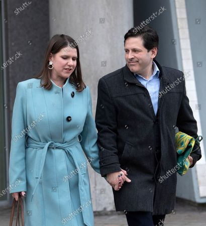 Britain's Liberal Democrats party leader Jo Swinson (L) and husband Duncan Hames (R) leave the Southbank centre in London, Britain, 13 December 2019. Britons went to the polls for a general election on 13 December 2019, which the Conservative Party has won an overall majority.