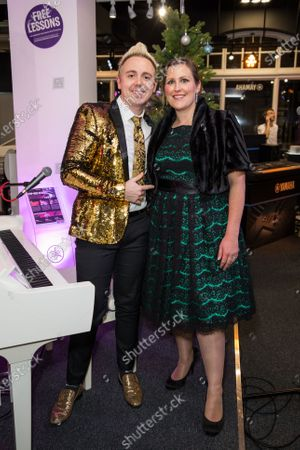 John Galea and Hannah Long pose for a photo during his music event at the Yamaha Store in Soho, London.