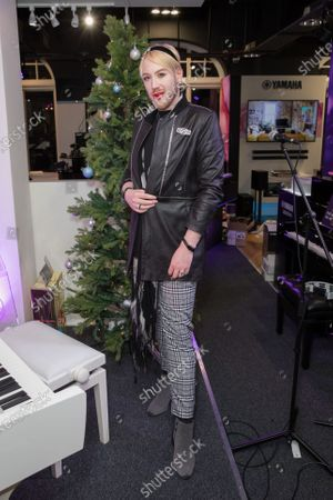 Lewis-Duncan Weedon attends the music event of John Galea performing festive songs at the Yamaha Store in Soho, London.