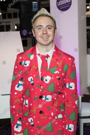 John Galea seen before performing festive songs at the Yamaha Store in Soho, London.