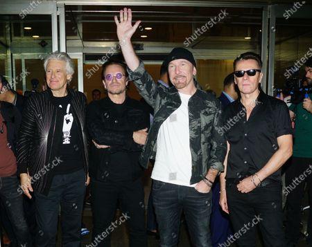 U2 - Adam Clayton, U2, The Edge and Larry Mullen Jr arrive at Mumbai airport