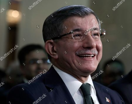 """Former Turkish Prime Minister Ahmet Davutoglu smiles before addressing his supporters after he launched """"The Future Party,"""" a splinter party to rival President Recep Tayyip Erdogan, in Ankara, Turkey, . Davutoglu is promising a return to a parliamentary democracy and to expand rights and freedoms"""