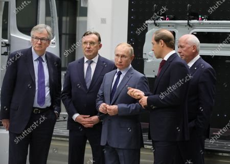 Russian President Vladimir Putin (C), accompanied by Kamaz Chief Executive Sergei Kogogin (2-L), Daimler Trucks Chief Executive Martin Daum (L), Ministry of Industry and Trade Denis Manturov (2-R) and Chief of Rostech state corporation Sergei Chemezov (R) visits the Russian truck maker Kamaz plant in Naberezhnye Chelny, Russia, 13 December 2019. Kamaz marks its 50-year anniversary.