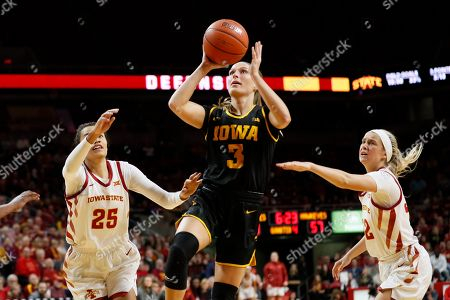 Iowa guard Makenzie Meyer (3) drives to the basket between Iowa State's Kristin Scott (25) and Maggie Espenmiller-McGraw, right, during the second half of an NCAA college basketball game, in Ames, Iowa. Iowa won 75-69
