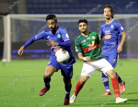 Al-Fateh's Mohammed Al Saeed (L) in action against Al-Ettifaq's Fawaz Al Tarees (C) and Al-Fateh's Gustav Wikheim (R) during the Saudi Professional League soccer match between Al-Ettifaq and Al-Fateh at Prince Mohammed bin Fahd Stadium, Dammam, Saudi Arabia, 13 December 2019.
