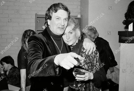 """Actor Danny Aiello hugs actress Beatrice Arthur at a party following their opening performance in Woody Allen's play, """"The Floating Lightbulb,"""" in New York. Aiello, the blue-collar character actor whose long career playing tough guys included roles in """"Fort Apache, the Bronx,"""" """"The Godfather, Part II,"""" """"Once Upon a Time in America"""" and his Oscar-nominated performance as a pizza man in Spike Lee's """"Do the Right Thing,"""" has died. He was 86. Aiello died after a brief illness, said his publicist, Tracey Miller"""