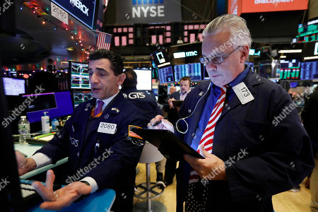 Peter Mazza, Frank O'Connell. Specialist peter Mazza. left, and trader Frank O'Connell work on the floor of the New York Stock Exchange, . After months of waiting, markets had a muted reaction to news Friday that the US and China had reached an initial deal on trade